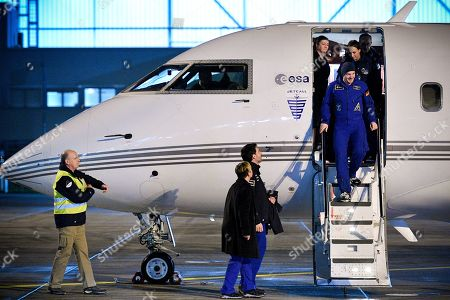 European Space Agency (ESA) astronaut Alexander Gerst (R, on gangway) of Germany disembarks from a plane as he arrives at the military part of the Cologne-Bonn airport, Germany, 20 December 2018. After 197 days in space, Alexander Gerst, who served as commander of the International Space Station ISS until his return, landed safely in a Soyuz MS-09 capsule near Karaganda in the steppe of Kazakhstan earlier this 20 December morning. A special aircraft brought him back to Germany with a stopover in Norway. After his return to earth, the 42-year-old will spend the next few days at the space medical research centre 'envihab' in Cologne, where he will be jointly supervised by the German Aerospace Center (Deutsches Zentrum fuer Luft- und Raumfahrt e.V., or DLR) and the European Astronaut Centre (EAC).