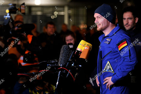 European Space Agency (ESA) astronaut Alexander Gerst (R) of Germany speaks to the media as he arrives at the military part of the Cologne-Bonn airport, Germany, 20 December 2018. After 197 days in space, Alexander Gerst, who served as commander of the International Space Station ISS until his return, landed safely in a Soyuz MS-09 capsule near Karaganda in the steppe of Kazakhstan earlier this 20 December morning. A special aircraft brought him back to Germany with a stopover in Norway. After his return to earth, the 42-year-old will spend the next few days at the space medical research centre 'envihab' in Cologne, where he will be jointly supervised by the German Aerospace Center (Deutsches Zentrum fuer Luft- und Raumfahrt e.V., or DLR) and the European Astronaut Centre (EAC).