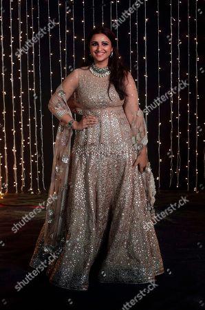 Bollywood actress Parineeti Chopra stand for photographs at Priyanka Chopra and musician Nick Jonas wedding reception in Mumbai, India