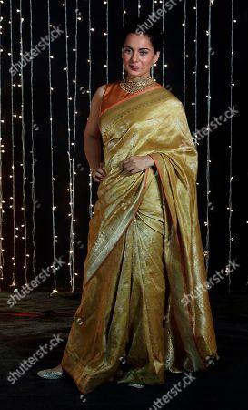 Bollywood actress Kangana Ranaut poses for photographs at Priyanka Chopra and musician Nick Jonas wedding reception in Mumbai, India