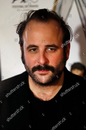 """Stock Photo of Actor Vincent Macaigne poses for photographers during the premiere of the movie """"Doubles vies"""" (Double Lives), in Paris"""