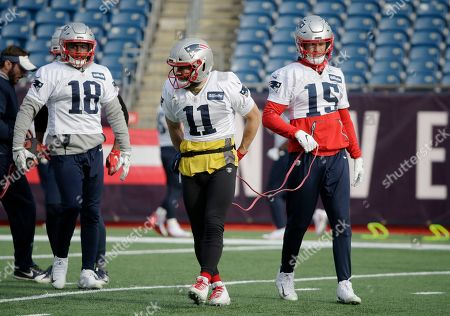 New England Patriots wide receivers Matthew Slater (18), Julian Edelman (11), and Chris Hogan (15), warm up during an NFL football practice, in Foxborough, Mass