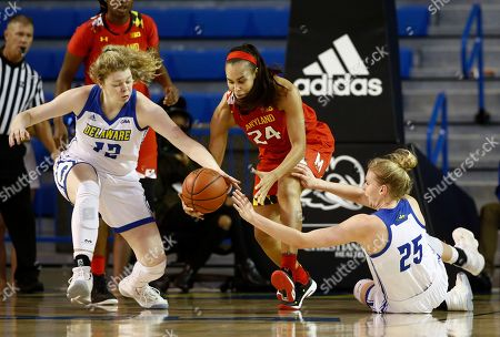 Stock Image of Lizzie O'Leary, Stephanie Jones, Rebecca Lawrence. Maryland forward Stephanie Jones, center, grabs possession of a loose ball in between Delaware forwards Lizzie O'Leary, left, and Rebecca Lawrence in the first half of an NCAA college basketball game, in Newark, Del