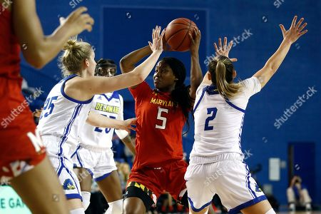 Stock Picture of Rebecca Lawrence, Kaila Charles, Abby Gonzales. Maryland guard Kaila Charles (5) looks for a teammate as she is pressured by Delaware forward Rebecca Lawrence (25) and guard Abby Gonzales (2) in the first half of an NCAA college basketball game, in Newark, Del