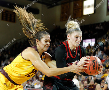 Central Michigan's Reyna Frost, left, and Louisville's Sam Fuehring vie for a rebound during the second quarter of an NCAA college basketball game, in Mount Pleasant, Mich