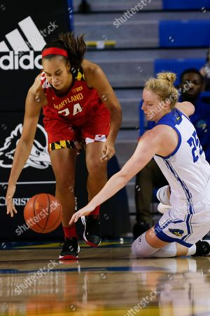 Maryland forward Stephanie Jones (24) and Delaware forward Rebecca Lawrence (25) scramble for the ball during an NCAA college basketball game, in Newark, Del