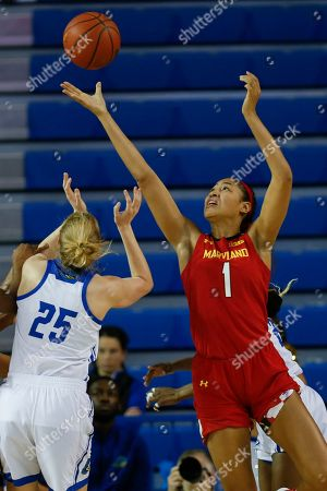 Maryland forward Shakira Austin (1) reaches for the ball over Delaware forward Rebecca Lawrence (25) during an NCAA college basketball game, in Newark, Del