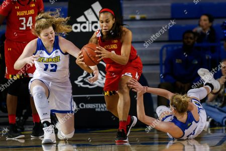 Maryland forward Stephanie Jones (24) and Delaware forward Rebecca Lawrence (25) and forward Lizzie O'Leary (12) scramble for the ball during an NCAA college basketball game, in Newark, Del