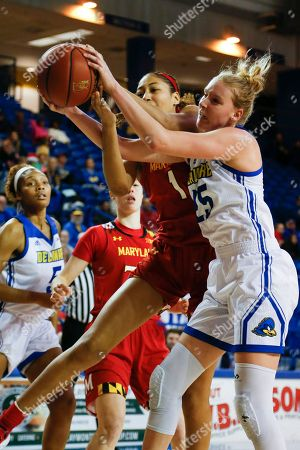 Stock Picture of Maryland forward Shakira Austin (1) and Delaware forward Rebecca Lawrence (25) fight for the ball during an NCAA college basketball game, in Newark, Del