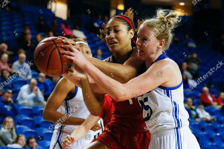 Maryland forward Shakira Austin (1) and Delaware forward Rebecca Lawrence (25) fight for the ball during an NCAA college basketball game, in Newark, Del