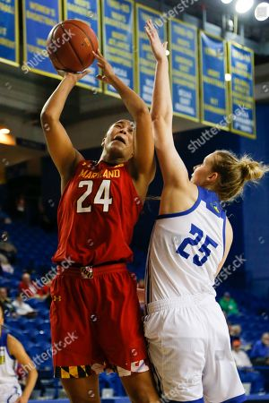 Maryland forward Stephanie Jones (24) takes a shot over Delaware forward Rebecca Lawrence (25) during an NCAA college basketball game, in Newark, Del