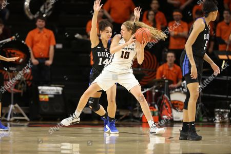 Oregon State guard Katie McWilliams drives the ball against Duke defender Faith Suggs during an NCAA college basketball game, in Corvallis, Ore