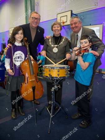 Big Noise Raploch brought down the curtain on their 10th Birthday celebrations with a very special Christmas concert. More than 150 children and young people took to the stage on Thursday 20th December and delighted audience members with a truly festive performance. Provest Christine Simpson with new chair of Sistema Benny Higgins (left) and  Councilor Scott Farmer (right)  with youngsters Sienna Harris (8) and Logan Miller (7)