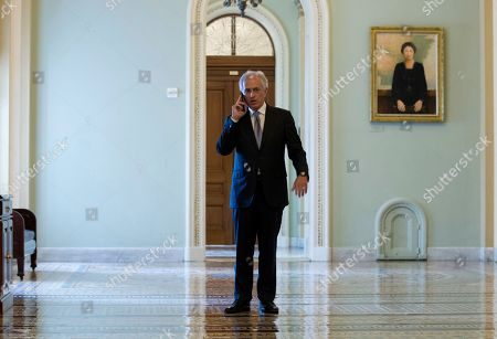 Senate Foreign Relations Committee Chairman Bob Corker, R-Tenn., speaks on the phone as the Senate takes up a House-passed bill that would pay for President Donald Trump's border wall and avert a partial government shutdown, at the Capitol in Washington