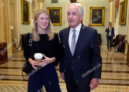 Senate Foreign Relations Committee Chairman Bob Corker, R-Tenn., arrives with his daughter Emily to the senate chamber, as the Senate takes up a House-passed bill that would pay for President Donald Trump's border wall and avert a partial government shutdown, at the Capitol in Washington