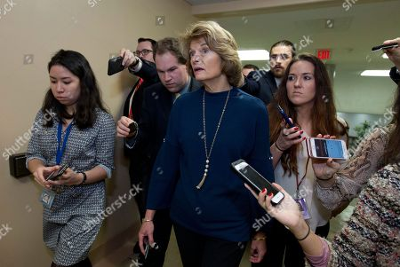Sen. Lisa Murkowski, R-Alaska, speaks to reporters on her way to the senate chamber, as the Senate takes up a House-passed bill that would pay for President Donald Trump's border wall and avert a partial government shutdown, at the Capitol in Washington