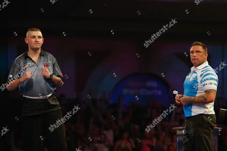 Nathan Aspinall celebrates, Gerwyn Price looks on, during the World Darts Championships 2018 at Alexandra Palace, London