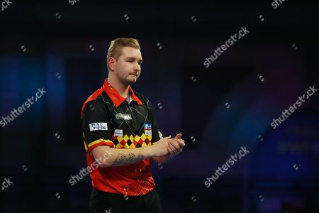 Dimitri Van den Bergh applauds the crowd and celebrates his win during the World Darts Championships 2018 at Alexandra Palace, London