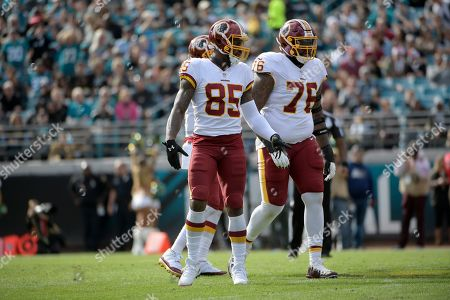 Washington Redskins tight end Vernon Davis (85) and offensive tackle Morgan Moses (76) set up for a play during the first half of an NFL football game against the Jacksonville Jaguars, in Jacksonville, Fla