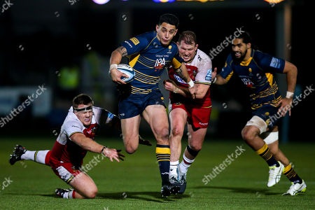 Stock Image of Bryce Heem of Worcester Warriors goes past Paul Hill of Northampton Saints and Dylan Hartley of Northampton Saints
