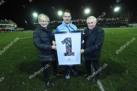 Gethin  Jenkins receives a print from Peter Thomas and Gareth Edwards to mark his retirement.