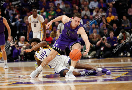 Furman guard Andrew Brown (5) chases down a loose ball against LSU guard Marlon Taylor in the first half an NCAA college basketball game in Baton Rouge, La