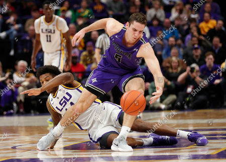 Furman guard Andrew Brown (5) chases down a loose ball in front of LSU guard Marlon Taylor during the first half an NCAA college basketball game in Baton Rouge, La