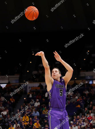 Furman guard Andrew Brown (5) attempts a 3-point shot during the second half the team's NCAA college basketball game against LSU in Baton Rouge, La., . LSU won 75-57