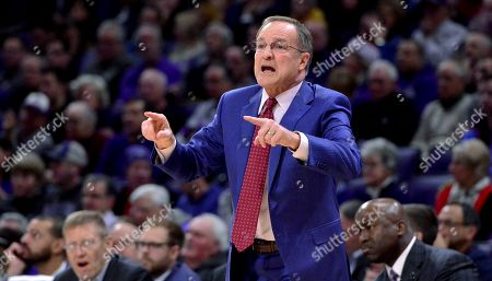 Oklahoma coach Lon Kruger gestures during the first half of the team's NCAA college basketball game against Northwestern, in Evanston, Ill