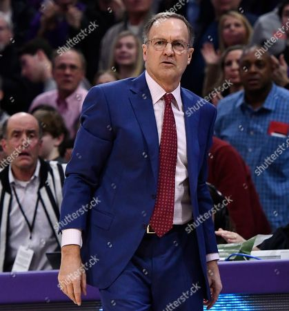 Oklahoma head coach Lon Kruger directs the team during the second half of an NCAA college basketball game against Northwestern, in Evanston, Ill
