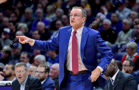Oklahoma head coach Lon Kruger directs the team during the first half of an NCAA college basketball game against Northwestern, in Evanston, Ill