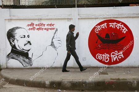 Bangladeshi people walk along a street past a mural showing Bangladesh Awami League (AL) Party's founder Bangabandhu Sheikh Mujibur Rahman and the party's election symbol of a boat (R) ahead of national polls in Dhaka, Bangladesh, 22 December 2018. According to the Bangladesh Election Commission, the 11th general election is scheduled on 30 December 2018 to select members of the national parliament, also known as Jatiya Sangsad.