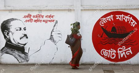 Stock Picture of Bangladeshi people walk along a street past a mural showing Bangladesh Awami League (AL) Party's founder Bangabandhu Sheikh Mujibur Rahman and the party's election symbol of a boat (R) ahead of national polls in Dhaka, Bangladesh, 22 December 2018. According to the Bangladesh Election Commission, the 11th general election is scheduled on 30 December 2018 to select members of the national parliament, also known as Jatiya Sangsad.
