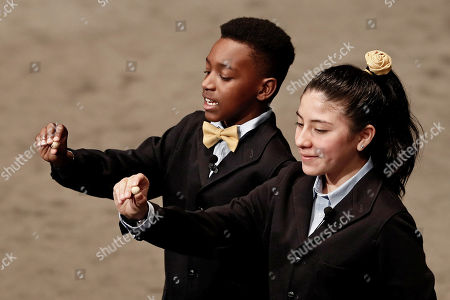 Stock Photo of San Idelfonso School students Yanisse Alexandra Soto (R) and Julian Steven Mendoza (L) sing the number 20202 corresponding to a fifth prize during the Spanish Christmas Lottery 'El Gordo' at the Teatro Real, Madrid Royal Opera House, in Madrid, Spain, 22 December 2018. The traditional Spanish Christmas Lottery 'El Gordo' (The Fat One) shares out a total of 2.38 billion euro this year's edition, the main ones per ticket are 400,000 euro for the first prize; 125,000 for the second and 50,000 for the third; 20,000 for the fourth; and 6,000 for the fifth.