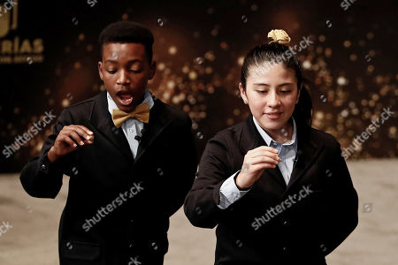 Stock Picture of San Idelfonso School students Yanisse Alexandra Soto (R) and Julian Steven Mendoza (L) sing the number 42206 corresponding to a fourth prize during the Spanish Christmas Lottery 'El Gordo' at the Teatro Real, Madrid Royal Opera House, in Madrid, Spain, 22 December 2018. The traditional Spanish Christmas Lottery 'El Gordo' (The Fat One) shares out a total of 2.38 billion euro this year's edition, the main ones per ticket are 400,000 euro for the first prize; 125,000 for the second and 50,000 for the third; 20,000 for the fourth; and 6,000 for the fifth.