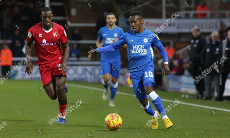 Siriki Dembele of Peterborough United in action with Isaiah Osbourne of Walsall
