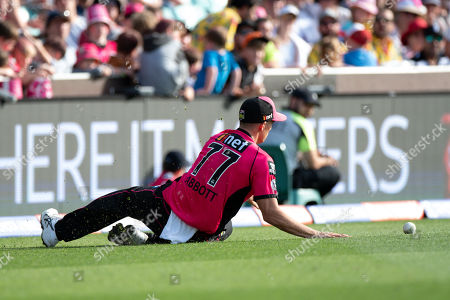 Sydney Sixers player Sean Abbott saves a four at the Big Bash League cricket match between Sydney Sixers and Perth Scorchers at The Sydney Cricket Ground in Sydney, Australia