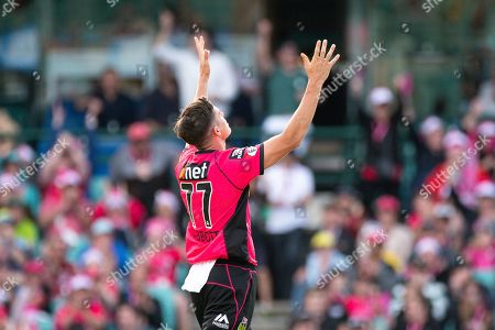 Sydney Sixers player Sean Abbott celebrates his wicket at the Big Bash League cricket match between Sydney Sixers and Perth Scorchers at The Sydney Cricket Ground in Sydney, Australia