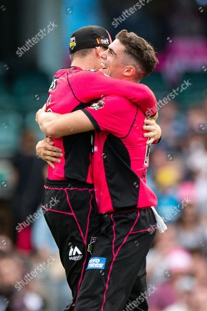 Sydney Sixers player Sean Abbott celebrates his wicket of Perth Scorchers player Will Bosisto at the Big Bash League cricket match between Sydney Sixers and Perth Scorchers at The Sydney Cricket Ground in Sydney, Australia