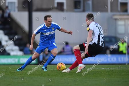 Notts County midfielder David Vaughan(8) and Grimsby Town midfielder Harry Clifton(15) during the EFL Sky Bet League 2 match between Grimsby Town FC and Notts County at Blundell Park, Grimsby