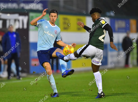 Callum Johnson (2) of Accrington Stanley is tackled by Ashley Smith-Brown (23) of Plymouth Argyle during the EFL Sky Bet League 1 match between Plymouth Argyle and Accrington Stanley at Home Park, Plymouth