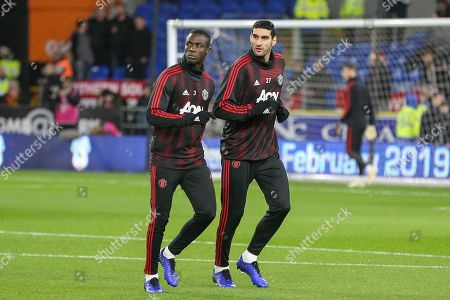Manchester United Defender Eric Bailly and Manchester United Midfielder Marouane Fellaini in warm up during the Premier League match between Cardiff City and Manchester United at the Cardiff City Stadium, Cardiff