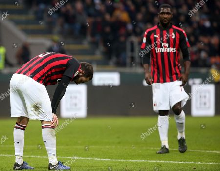 Milan's Gonzalo Higuain (L) and his teammate Cristian Zapata  show their disappointement during the Italian serie A soccer match AC Milan and ACF Fiorentina  at Giuseppe Meazza stadium in Milan, Italy, 22 December 2018.