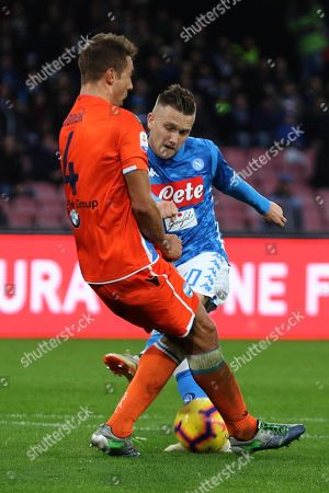 Spal's Thiago Cionek (L) and Napoli's Piotr Zielinski in action during Italian Serie A soccer match SSC Napoli vs S.P.A.L. at the San Paolo stadium in Naples, Italy, 22 December 2018.