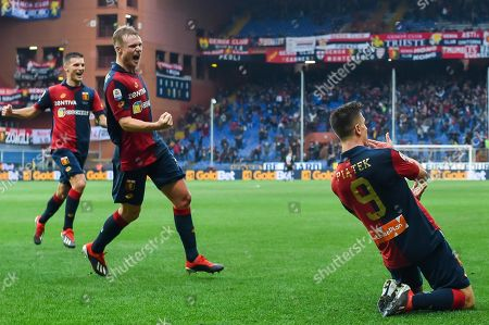 Genoa's Krzysztof Piatek (R) celebrates with his teammates  Darko Lazovic and Oscar Hiljemark after scoring the 1-0 goal during the Italian Serie A soccer match Genoa CFC vs Atalanta BC at Luigi Ferraris Stadium in Genoa, Italy, 22 December 2018.