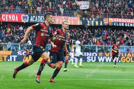 Genoa's Krzysztof Piatek (L) celebrates with his teammate Oscar Hiljemark after scoring the 1-0 goal during the Italian Serie A soccer match Genoa CFC vs Atalanta BC at Luigi Ferraris Stadium in Genoa, Italy, 22 December 2018.