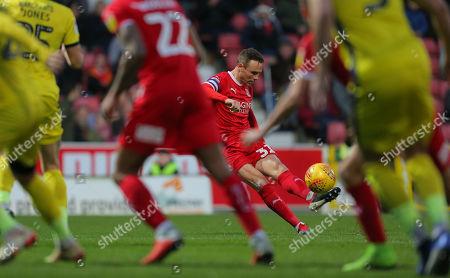 Stock Image of Matthew Taylor of Swindon  takes a free kick