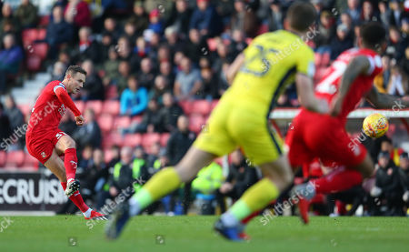 Matthew Taylor of Swindon  shoots at the goal