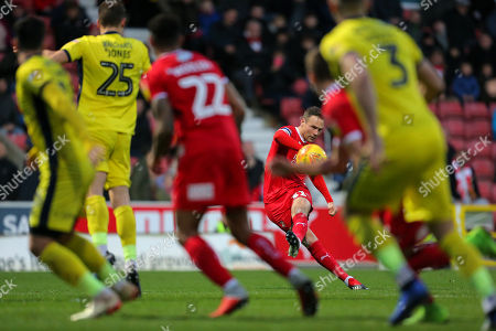 Matthew Taylor of Swindon  shoots at the goal from a free kick