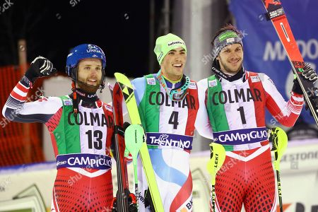 From left, second placed Austria's Marco Schwarz, first placed Switzerland's Daniel Yule and third placed Austria's Michael Matt celebrate at finish area at the end of a ski World Cup Men's Slalom, in Madonna Di Campiglio, Italy